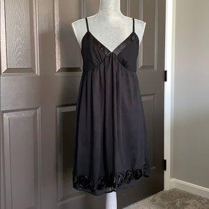 Medium little black dress with rosette detail